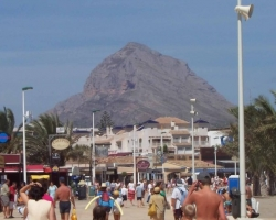 Restaurant strip at the Arenal Beach Javea with Montgo in the background